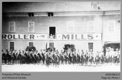Paris-Burford Rough Riders in front of Roller Mills