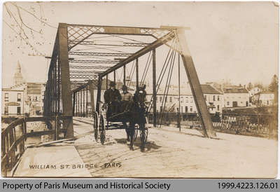 Postcard depicting Penman driving across the William St. Bridge, c. early 20th century