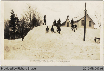 Children Playing in Snowdrift, Scotland, Ontario, 1947