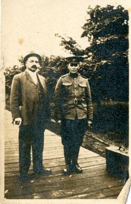 Photograph of 2 men on a boardwalk