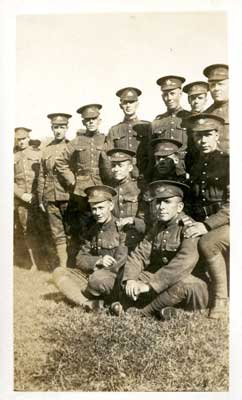 Group photo of 11 soldiers with 2 seated on the grass