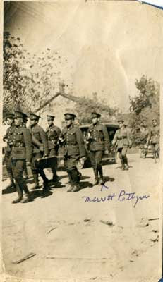 8 soldiers walking down a road