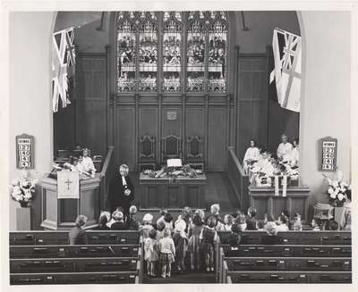 Rev. MacMillan leading children's lesson during service between 1962-1965.
