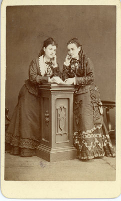 Two Young Women Posing in Symmetry