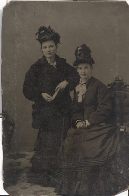 Two Women With Elaborate Hats