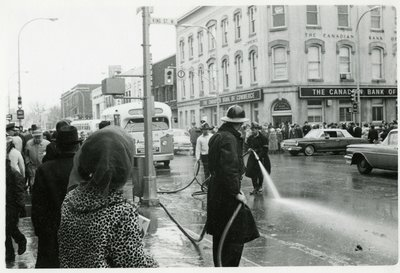 LH2828 Firemen at intersection of Simcoe and King Streets, facing northeast