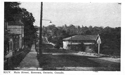 Main street of Rosseau (old Parry Sound Road / HWY 141) - Postcard - RV0031
