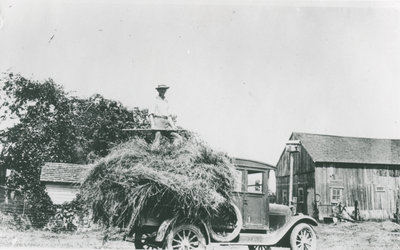 Thomas DeWell with Hay