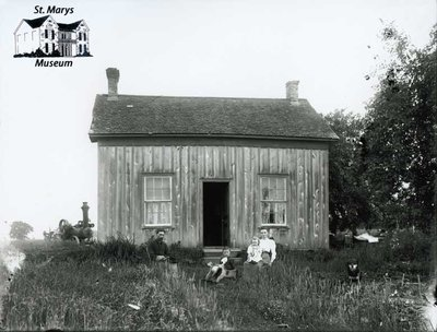 Board and Batten House with Family, Steam Engine, c. 1902-1906