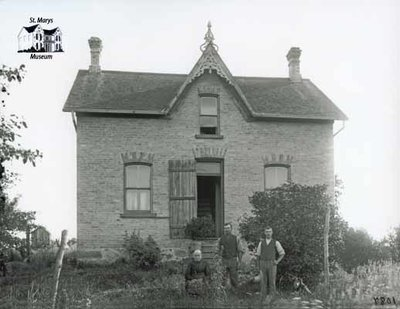 Two Men and a Woman with Brick Farmhouse, c. 1902-1906