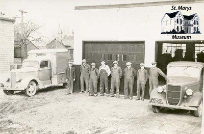 Public Utilities Crew in Front of Garage
