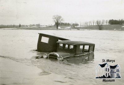 Two Cars in the River