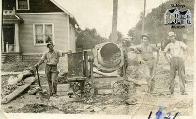 Men Stand with Concrete Mixer During Queen Street Construction