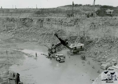 Electric Shovel and Side Dump in Old Quarry