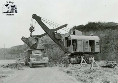 Electric Shovel and Dump Truck in Old Quarry