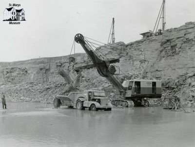 Marion Electric Shovel and Side Dump in Old Quarry
