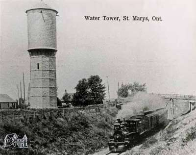 Water Tower with GTR steam engine passing under the Queen Street overpass; early 1900s