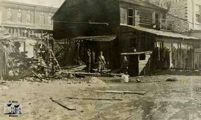 Aftermath of fire at Gregory Block (South side of Queen Street between Wellington and Water Street), 1921