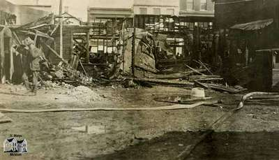 Aftermath of fire at Gregory Block (South side of Queen Street between Wellington and Water Streets), 1921