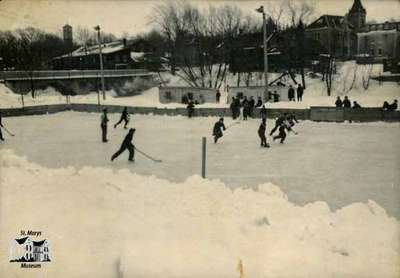 Outdoor hockey at Wellington Street ice rink, ca. 1950s