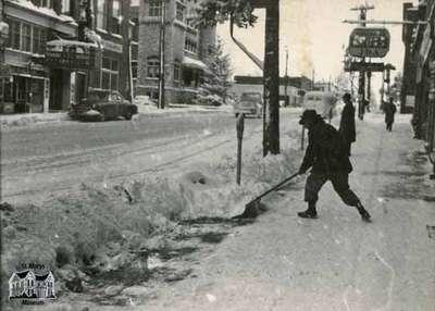 Snow shoveling on Queen Street East, ca. 1960