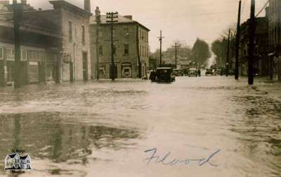 Queen Street looking west towards Water Street at the time of a flood, 1937