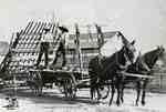 Team of horses pulling wagon and hay loader