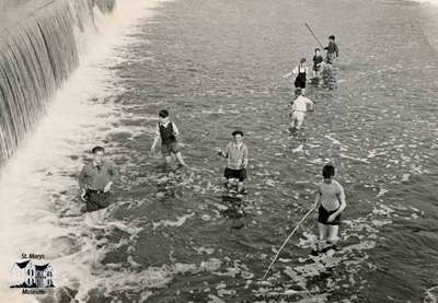 Boys fishing beneath the falls (2 pictures)