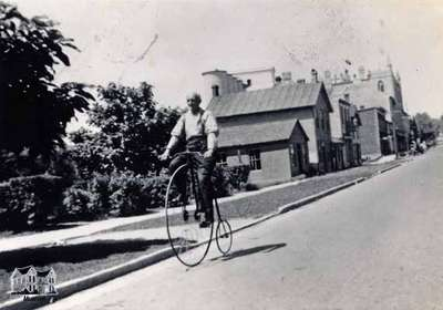 John Brown riding a penny farthing bicycle