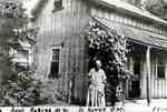 Regina Riddell in front of Widder Street East home