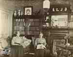 Mrs. Clench and Miss Cruttenden in the living room of the Clench home