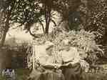 Mrs. Clench and Miss Elizabeth Cruttenden in the garden of the Clench house