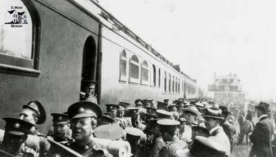 249th Battalion boarding train at station in Regina