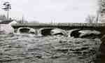 Water rushing under the Victoria bridge, 1947