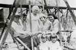 5 women and 2 children posed on garden swing