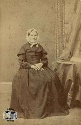 Elderly woman seated
