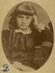 Young girl with ringlets; seated