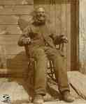 James (Jimmy) Tate seated in his rocking chair