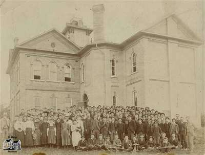 Class standing in front of school, 1893