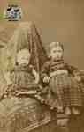 Two young children seated