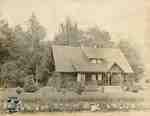 Log Cabin (landscaped house)