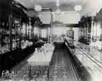 Interior of Andrews' store with gas lighting