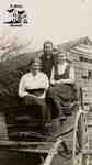 Mary and Jean White with their Aunt Nettie Fairbairn on a buggy