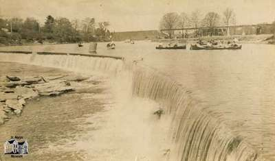 The Falls with canoes on Rice Lake