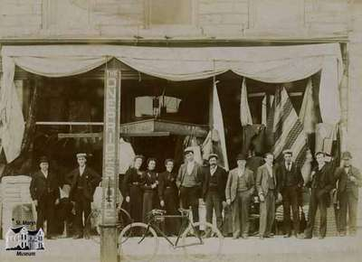 White and May storefront with staff