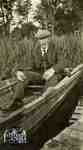 Duncan Weir in a rowboat