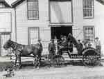 Horse drawn buggy and group of men
