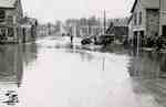 Water Street looking north to the bridge over Trout Creek during flood of 1937