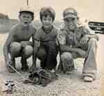Three boys with a snapping turtle