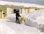 Unidentified Man Using a Snow Blower
